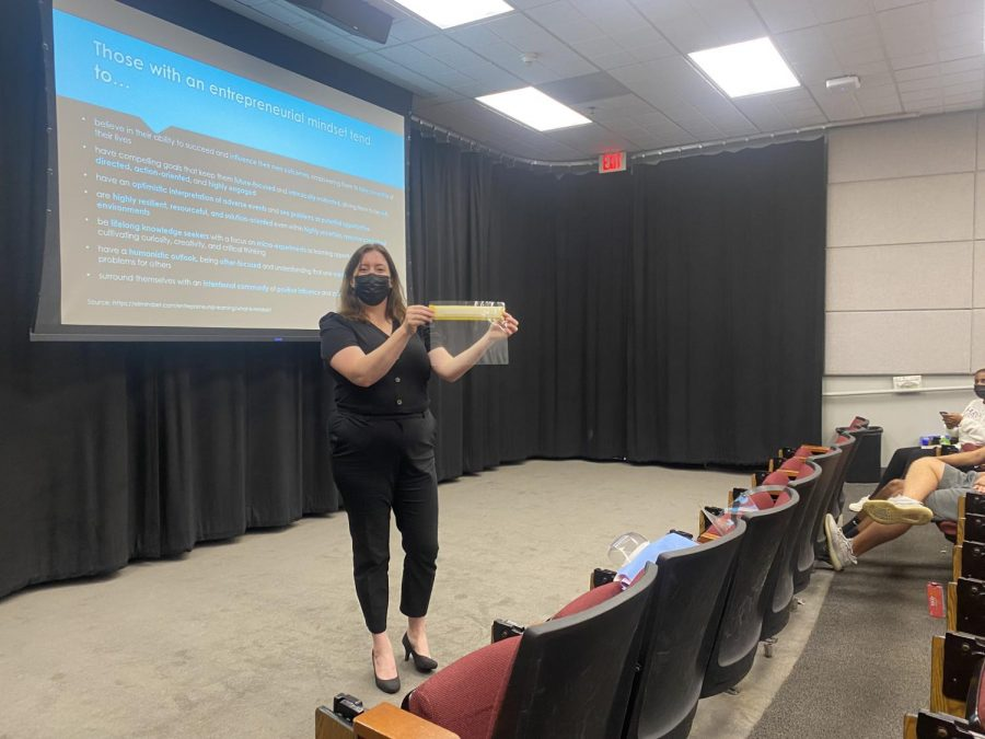 HW Venture Teacher Anne Wellington displays the face shield she helped manufacture at Cedars-Sinai Medical Center as part of a HW Venture presentation in Ahmanson Lecture Hall. While at Cedars-Sinai, she also helped produce hand sanitizer.